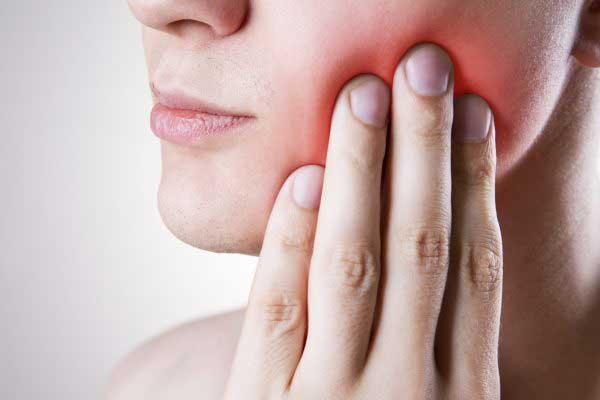علائم و نشانه های دندان عقل نهفته
