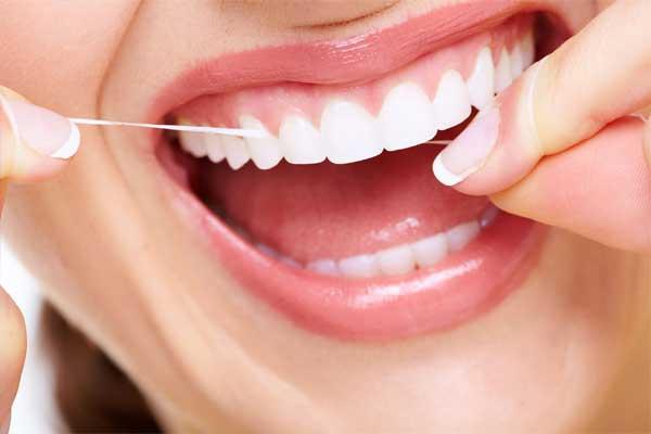 عوارض نخ دندان کشیدن ایمپلنت